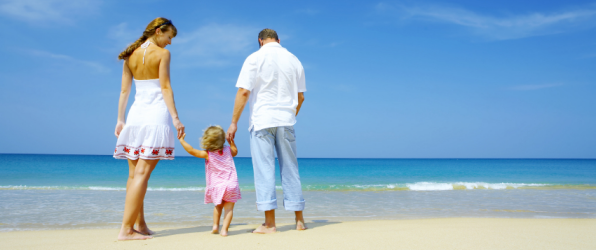 Family on a beach to illustrate article about accidents on holiday